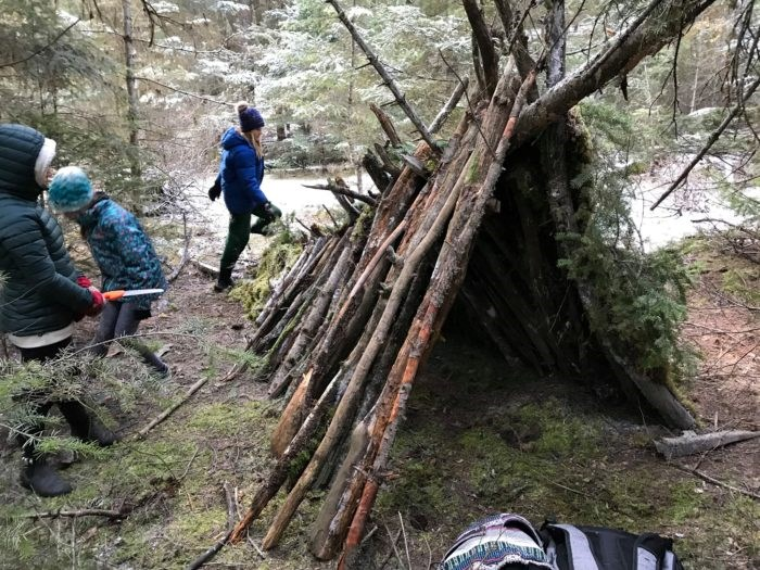 Kids out walking around a Teepee