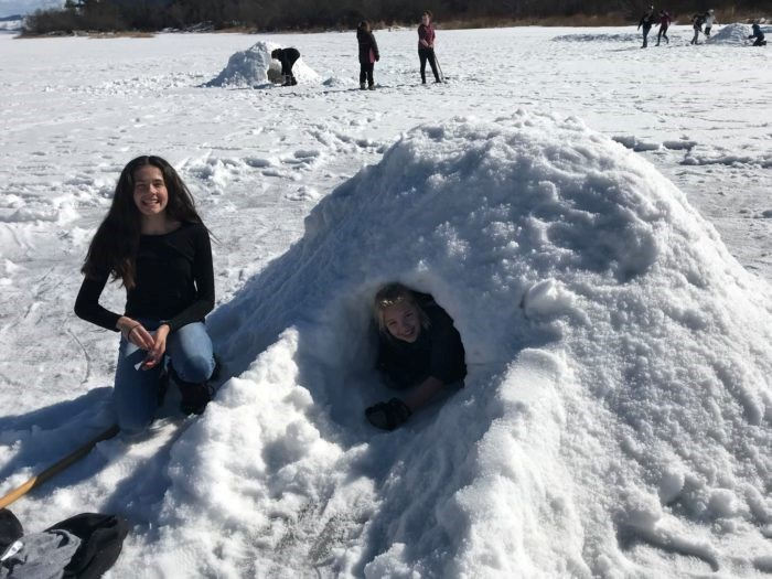 Kids playing in a makeshift Igloo